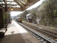A Manchester bound service, formed by Northern unit 158872, passes the signal box at Hebden Bridge as it draws to a halt in the Up platform. The box has recently been refurbished and controls colour light signals on a section of the Calder Valley line.<br><br>[Mark Bartlett&nbsp;04/04/2009]