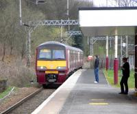 A Balloch - Airdrie train, formed by 320 311, arives at Renton on 1 April 2009.<br><br>[David Panton&nbsp;01/04/2009]