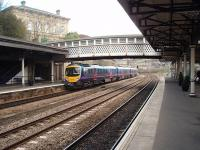 In addition to the platform tracks, one of the two through roads at Dewsbury was reinstated to cope with increased traffic. It allows fast trains heading for Leeds to overtake slower services and is well used. Transpennine Express unit 185134 leaves for Leeds and Middlesbrough in a view taken from just outside Dewsbury's increasingly popular station buffet bar, the start of a <I>Rail Ale Trail</I> through Huddersfield to Stalybridge. [See image 31409] for the same view in 1986.<br><br>[Mark Bartlett&nbsp;04/04/2009]