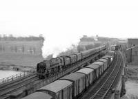 Occupation of all lines north of Carlisle in the mid 1960s as Britannia Pacific 70035 <I>Rudyard Kipling</I> crosses the Eden with a northbound train. Withdrawn from Kingmoor shed at the end of 1967, no 70035 was one of the 35 ex-BR steam locomotives recorded as having been cut up in the yard of T W Ward, Inverkeithing, in this case in March 1968.  <br> <br><br>[Robin Barbour Collection (Courtesy Bruce McCartney)&nbsp;//]