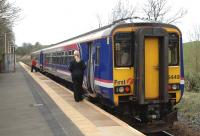 A Glasgow Central - East Kilbride service waits to depart from Thorntonhall on 6 April.<br> <br><br>[John Steven&nbsp;06/04/2009]