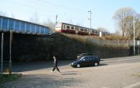 A westbound train, having crossed Duke Street, heads for Glasgow city centre on 2 April 2009. What is now <I>The Forge</I> shopping centre stands beyond the twin bridges on the other side of the embankment.<br><br>[John Furnevel&nbsp;02/04/2009]