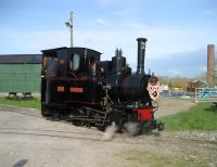 O&K 0-4-0T+WT <I>Montalban</I> in the guise of <I>Monty the Friendly Engine</I>, running round the train at Becconsall on the West Lancashire Light Railway on 5 April 2009. The chimney in the background shows the original use of this site, a brick works with its own clay pit.<br> <br><br>[John McIntyre&nbsp;05/04/2009]