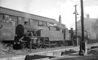 BR Standard, Ex-LMS and Ex-LNER types lined up alongside the north wall of St Margarets shed in 1964. From left to right stand 80122, 42691 and 61404. <br> <br><br>[K A Gray&nbsp;09/08/1964]