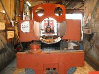 There's something missing! Kerr Stuart <I>Joffre</I> 0-6-0T+WT sits in the shed at Becconsall on the West Lancashire Light Railway. The locomotive was one of 70 built for the French Government Artillery Railways during World War 1. It had been in use in a quarry near Calais from after the war and was repatriated to the UK in 1974 in a derelict state. Initially it was stored, but restoration has now been underway for a number of years. Seen through the gap between the two side tanks where the boiler and smokebox should be is Quarry Hunslet <I>Irish Mail</I> resting between turns on the <I>Friendly Engines Day</I> service on 05 April 2009. [See image 36154]<br> <br><br>[John McIntyre&nbsp;05/04/2009]