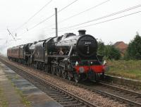 Heading north to Glasgow in preparation for the <I>Great Britain II</i> railtour leg from Glasgow to Inverness on the 10th are Black 5 pairing of 45231 <I>The Sherwood Forester</I> and 45407 <I>The Lancashire Fusilier</I>. They are seen passing Leyland at 0739 hrs on 09 April 2009.<br><br>[John McIntyre&nbsp;09/04/2009]