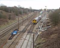 Prior to the Easter weekend relaying of Farington Curve Junction there was considerable preparatory work including creating a new access road and the installation of lighting columns. This view of 158855 negotiating the junction on a York to Blackpool service shows these preparation works.  <br><br>[Mark Bartlett&nbsp;27/02/2009]