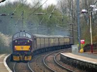 The <I>Scottish Chieftain</I> rail tour passing through Johnstone on 12th April on its leg from Paisley to Stranraer with 37676 <I>Loch Rannoch</I> bringing up the rear.<br><br>[Graham Morgan&nbsp;12/04/2009]