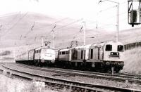 For reasons unknown, a pair of EE Type 1s attached to the front of a WCML train in the up loop at Abington in 1980 being passed by another southbound service.<br><br>[Colin Miller&nbsp;//1980]