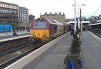 67 003 with the EWS-stocked 1708 Fife Outer Circle service, standing at Haymarket, with more spare seats than normal, being Good Friday 10 April 2009.<br><br>[David Panton&nbsp;10/04/2009]