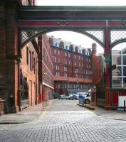 On the south side of Rutland Street the former entrance to Edinburgh's Princes Street station still stands, complete with gates, in April 2009. The rear of the Caledonian Hotel still looks over the area once occupied by the station concourse, although today's view is over a car park to the buildings of Edinburgh's financial district.<br><br>[John Furnevel&nbsp;07/04/2009]