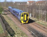 The bald-looking 159 782, long painted out of SWT livery but still unbranded, passes Thornton West Junction approaching Glenrothes with Thornton station with an outer circle service.<br><br>[David Panton&nbsp;14/04/2009]