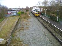 Merseyrail EMU 507011 waits at Ormskirk before returning to Liverpool Central on 30 March 2009. Ormskirk station building on the old Up platform (now the only one in use) is undergoing extensive refurbishment at present and basic temporary facilities are currently in place.<br> <br><br>[John McIntyre&nbsp;30/03/2009]