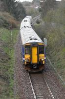 The 4-car 16.43 Glasgow Central to East Kilbride service, approaching its destination on 4 April. <br><br>[John Steven&nbsp;04/04/2009]