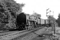 Britannia Pacific 70021 (formerly <I>Morning Star</I>) heads north past Eamont Bridge Junction, approaching Penrith, with a parcels train in September 1967. The locomotive was withdrawn from Kingmoor shed 3 months later and cut up at Wards, Inverkeithing, in April 1968.<br><br>[Colin Miller&nbsp;25/09/1967]