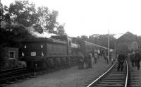 65234 on a railtour at Penicuik in August 1964. [See image 23124]. District Operating Inspector Kerr stands in the 4 foot on the right, hands behind his back, keeping an eye on the proceedings.<br><br>[K A Gray&nbsp;29/08/1964]