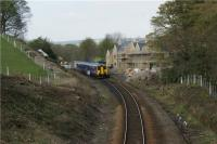 A Clitheroe to Manchester Victoria service operated by Northern Rail using 156497 passes the former station at Turton on 18 April 2009.<br><br>[John McIntyre&nbsp;18/04/2009]