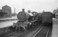 40920 in a bay platforms at Dumfries in April 1958. The former Caledonian goods shed on the left looks over the station.<br><br>[Robin Barbour Collection (Courtesy Bruce McCartney)&nbsp;15/04/1958]