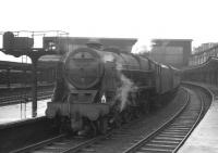 Royal Scot 46148 <I>The Manchester Regiment</I> stands at the south end of a wet Carlisle station on 22 August 1964 with the 7.11pm stopping train for Warrington Bank Quay.<br><br>[K A Gray&nbsp;22/08/1964]