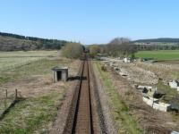 The site of Cairnie Junction looking north towards Grange. The spur to Grange North Junction branched off to the right around where the trees are today.<br> The line now passes through what was the island exchange platform for the Keith and Moray Coast lines. In it's day the line here was double-track and almost all the area in the foreground would have been occupied by railway lines and sidings.<br><br>[John Williamson&nbsp;19/04/2009]