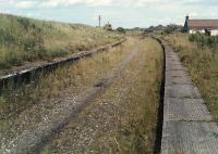 Looking east at Westcraigs in pre footpath days. Indeed at this time very few scrambler bikes roared up and down the trackbed. Where will they all go when the line re-opens? Today only one platform remains intact here following the conversion into a footpath.<br><br>[Ewan Crawford&nbsp;//1988]