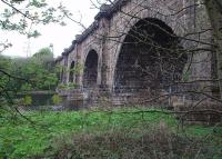 Viewed from the Lancaster to Wennington trackbed, John Rennie's Lune Aqueduct carries the Lancaster Canal across the River Lune on five arches, each spanning 70' and at least 50' above the river. This significant engineering achievement cost �48,000 in 1797, almost three times its original estimate, and is still open for canal traffic having outlived the railway by over 40 years already. Map Ref SD 485639. <br><br>[Mark Bartlett&nbsp;24/04/2009]