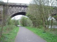 Although the Lune Aqueduct of the Lancaster Canal was built (in 1797) more than 40 years before the railway one of its five 70' arches was able to accomodate the double track Wennington line. Later, Lancaster Power Station was built here and a third line under the arch served coal sidings operated by fireless locomotives [See image 27588] until closure in 1981. View down the trackbed cycle path towards Lancaster Green Ayre.<br><br>[Mark Bartlett&nbsp;24/04/2009]