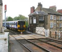 A service that has terminated at Knaresborough leaves the arrival platform and runs past the notable stone signal box towards the crossover, prior to running back into the station to start its return journey to Leeds.<br><br>[John Furnevel&nbsp;24/04/2009]
