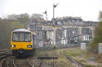 Pacer 144009 enters Harrogate from the north with a Knaresborough - Leeds service on 17 April 2009.� The signal gantry in the background formerly spanned the goods yard throat.<br> <br><br>[Bill Roberton&nbsp;17/04/2009]