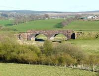 Twin arch bridge adjacent to the hamlet of Caldermill, on the former Caledonian route between Strathaven and Ryeland, Lanarkshire, photographed in April 2009. This section of the line was closed completely in 1951.<br><br>[Ken Browne&nbsp;21/04/2009]