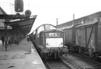 Train 1S58, the 11.10am summer Saturday Blackpool North - Kirkcaldy prepares to leave Carlisle platform 1 on 31 July 1965 behind Claytons D8581+D8582.<br><br>[K A Gray&nbsp;31/07/1965]