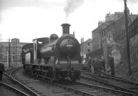J36 no 65234 stands at North Leith with a branch line railtour in 1964. The figure on the right is District Operating Inspector David G Kerr, a well known face on many such specials.<br><br>[K A Gray&nbsp;29/08/1964]