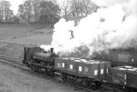 Located between Carron and Aberlour on the Speyside line, the Dailuaine distillery boasted its own steam locomotive, seen here in charge of a precious cargo near the distillery in the 1960s. [See image 5704]<br> <br><br>[Robin Barbour Collection (Courtesy Bruce McCartney)&nbsp;//]
