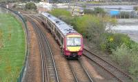 Edinburgh bound 170 470 passes the disused Burntisland East Junction on 18 April 2009. The junction once provided access to Burntisland docks and locomotive shed, as well as the pier originally used by train ferries to and from Granton prior to the opening of The Forth Bridge in 1890. <br> <br><br>[David Panton&nbsp;18/04/2009]