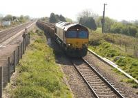 EWS 66156 westbound on a stone train through Pilning, at the eastern end of the Severn Tunnel on 21 April, running slowly through the loop towards the Tunnel.<br><br>[Peter Todd&nbsp;21/04/2009]