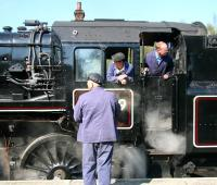 <I>Railwaymen</I>. Scene on the NYMR at Grosmont station on 20 April 2009. Locomotive 76079 is preparing to leave with a train for Pickering. <br><br>[John Furnevel&nbsp;20/04/2009]