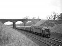 EE Type 4 with a southbound WCML service passing through Wreay cutting, south of Carlisle, in February 1965.<br> <br><br>[Robin Barbour Collection (Courtesy Bruce McCartney)&nbsp;13/02/1965]