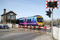 The 1047 Scarborough - Liverpool Lime Street TransPennine service runs west over Castlegate level crossing towards its stop at Malton on 22 April 2009.<br><br>[John Furnevel&nbsp;22/04/2009]