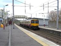 Scene at Wishaw on 29 April, as 318 255 calls with a Lanark to Dalmuir direct service.<br><br>[David Panton&nbsp;29/04/2009]