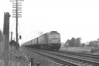 A Brush type 4 takes a train south on the ECML from Edinburgh circa late 1970s near St Germains level crossing.<br><br>[Bruce McCartney&nbsp;//]
