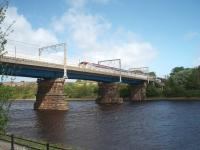 Carlisle Bridge, Lancaster, carrying the West Coast Main Line over the River Lune and seen here at High Tide from St. Georges Quay on the south side. The bridge was substantially rebuilt in the 1960s and a footbridge added to the east side as seen here. The southbound Pendolino is slowing for the Lancaster stop. The old Morecambe to Lancaster Green Ayre line passed under an arch of this bridge on the far bank.  <br><br>[Mark Bartlett&nbsp;07/05/2009]