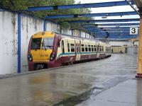 334 018 waits in the rain at Gourock platform 3 on 6 May 2009.<br><br>[David Panton&nbsp;06/05/2009]