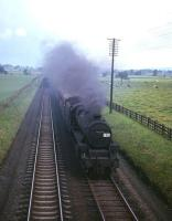 Black 5 no 45297 heads south with a train on the WCML near Plumpton on the approach to Penrith in the 1960s. [See image 34843]<br> <br><br>[Robin Barbour Collection (Courtesy Bruce McCartney)&nbsp;//]