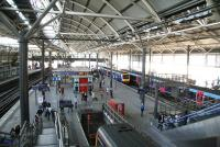 The South side of Leeds station seen from the footbridge on 22 April. View is east towards York with First TransPennine services for Hull and Liverpool Lime Street standing at platforms 15 and 16.<br><br>[John Furnevel&nbsp;22/04/2009]