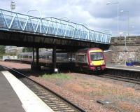 170 476 emerges from the triple bridge at Larbert on 7 May with an Alloa - Glasgow Queen Street service.<br><br>[David Panton&nbsp;07/05/2009]