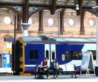 Northern 158792 stands in bay platform 1 at York on 22 April 2009 forming the next train for Hull. Meantime, two relaxed looking ladies enjoy the sunshine on platform 3, while awaiting the arrival of a southbound ECML service.<br><br>[John Furnevel&nbsp;22/04/2009]