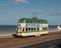 Most of Blackpool's trams seem to be in garish advertising liveries these days so it was nice to see <I>Balloon</I> double deck car 723 in Corporation Green and Cream, albeit this is one of the modified trams with modern bus windows installed to replace the originals. It is seen here on driver training duty, complete with L plates, heading north from Blackpool passing the Imperial Hotel on the elevated stretch of promenade south of Gynn Square. A new tram stop was later constructed at this point as part of the refurbishment of the tramway. [See image 37614]<br><br>[Mark Bartlett&nbsp;12/05/2009]