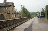 Chapel-en-le-Frith station looking towards Buxton on 13 May 2009. The station building on the Buxton platform is now the Brief Encounter restaurant. There is no footbridge between the platforms and access between them is by way of the foot crossing behind the photographer.<br><br>[John McIntyre&nbsp;13/05/2009]