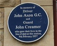 The plaque on the wall of the former station building at Chapel-en-le-Frith commemorating John Axon GC and John Creamer. [Railscot note: On 9 February 1957, driver Axon's freight train was returning from Buxton in the Derbyshire Peak District to his home depot at Edgeley, Stockport, when the steam brake pipe fractured. Despite exposure to scalding steam, he urged his fireman to jump to safety and hung on the outside of the cab as the train picked up speed, reaching 80mph down a long incline. His shouted warning to the signalman at Doveholes enabled a DMU at Chapel-en-le-Frith to be moved to safety but his own life was lost as his engine crashed into the rear of a freight train there. John Creamer, the guard on the second train, also died in the crash. John Axon was posthumously awarded the George Cross.]<br> <br><br>[John McIntyre&nbsp;13/05/2009]