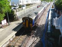 156 450 at the head of a 4-car service to Glasgow Central stands in bright sunshine at Dunlop on 13 May as work progresses alongside on the second platform.<br><br>[Ken Browne&nbsp;13/05/2009]